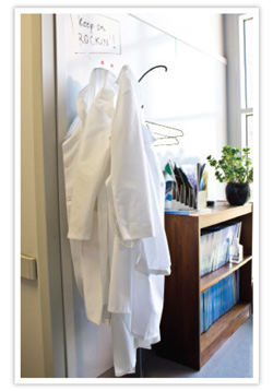 lab coats hanging in an office
