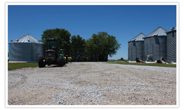 farm yard with silos and tractor